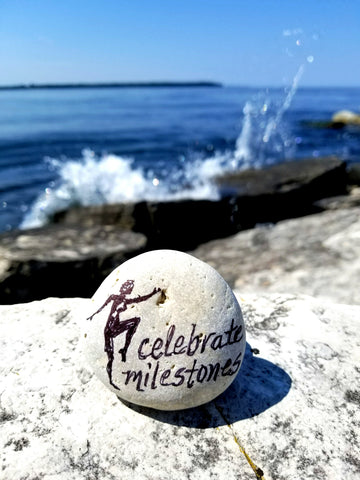 Celebrate milestones painted rock by Bethany Kirwen USA