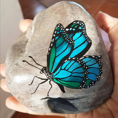 painted rock butterfly art by Tunde Fodor of RockStreet Collective