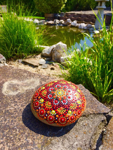 mandala red dots painted rocks meditation nature energy