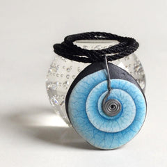 painted rock wearable art blue swirl Lysa Mignot