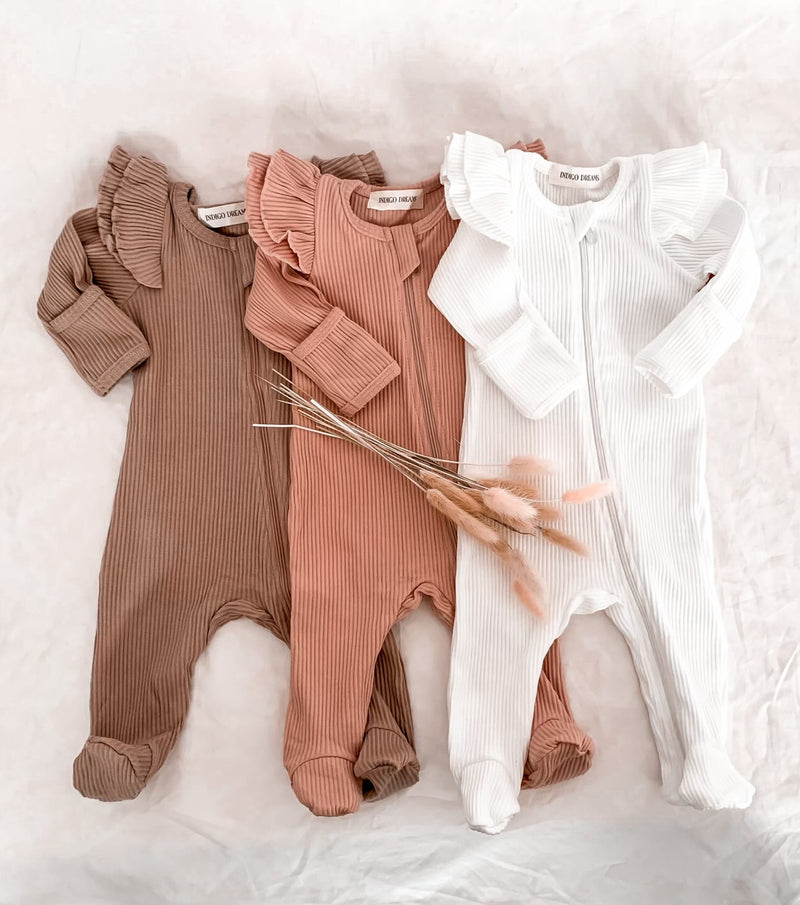 White Ruffle Zippy Onesie
