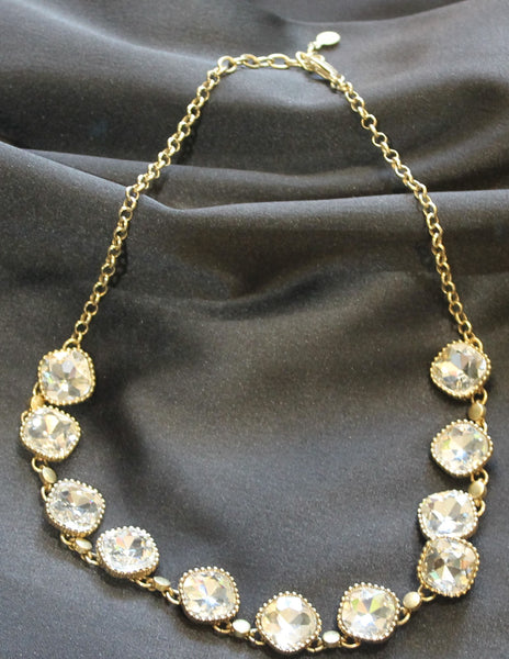 Gold tone necklace with crystal like stones.