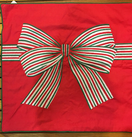 Red pillow case with Christmas bow