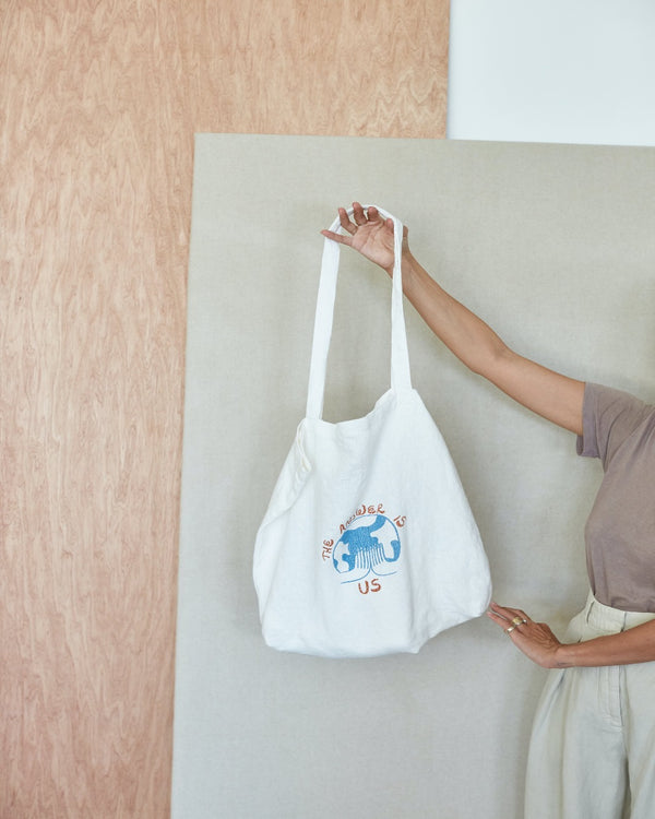 """The answer is us"" linen tote"