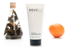 NEUÚ Hair & Body Wash surrounded by an orange and a jar of seaweed, the best product for your skin type