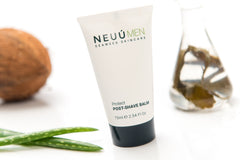 NEUÚ MEN Post-Shave Balm, surrounded by a coconut, aloe leaf and a glass jar of seaweed, the best choice of product for your skin type