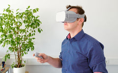 Man wearing vitural reality headset to experience virtual reality as a gift for Father's Day