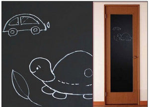 image of a turtle and a car on a black board sticker on a door