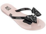 Melissa Kid's pink and black jelly flip flops with bow