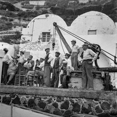 Port workers, mules and travelers in the port of Gialos. Robert McCabe The simplistic Santorini of the '50s 1 - tripatricks linking people to adventure