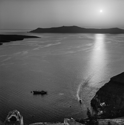 A sailboat arrives by motorbike in Gialos just before sunset. A small conveyor is tied to an arodo buoy. In the background Thirasia and a part of the volcano on the left. Robert McCabe The simplistic Santorini of the '50s 5 - tripatricks linking people to adventure