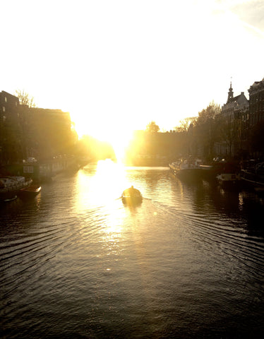Tripatricks_Amsterdam_River_Canal_Boat_Sunset