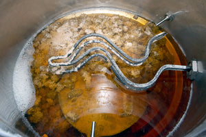 Coagulated proteins and whole hops at the bottom of the Boil Kettle. The wort itself should be clear which is the sign of a good vigorous boil and proper use of clarifying agents.