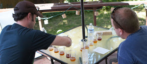 Brewers tasting samples of IPAs