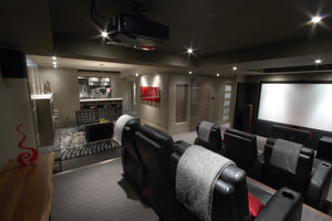 View across the basement home theater into the lounge and bar