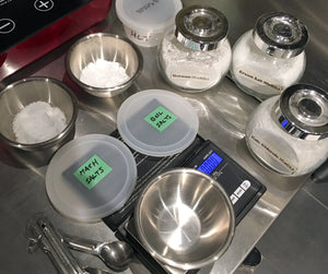 Measuring salt additions into two containers labelled 'mash' and 'boil'