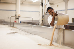 Ramon pitches yeast into an open fermenter at Anchor Brewing of San Francisco