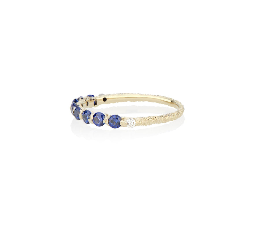Royal Blue Sapphires cast not set in to 18kt Gold in model turned jeweler Jayne Moore's signature rebel set style using recycled refined golds and sustainable responsibly sourced stones, handmade in NYC stones inspired by the Sicilian sea conflict free diamonds and richly hand textured band