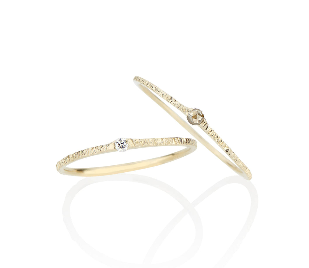 dainty delicate diamond stackable rings made by designer jayne moore in nyc using recycled gold and conflict free diamonds handmade by the model jayne moore writer