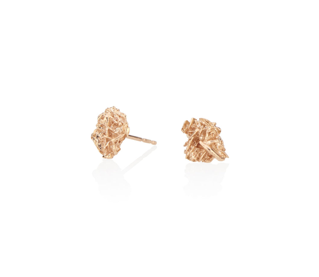 unique gold stud earrings cool everyday earrings with a difference made from a desert rose natural material cast into solid gold keeping the raw and fascinating texture of this natural phenomenon all handmade in NYC by model jayne moore writer jayne moore jeweler all recycled gold