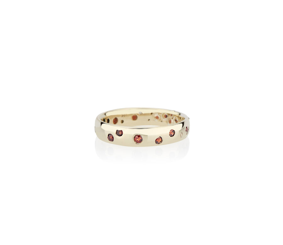 Rubies sunk in to recycled gold in model and jewelry designer Jayne Moore's signature style handmade in New York city using recycled metals freestyle stone setting confetti ring rubies garnets sapphires diamonds