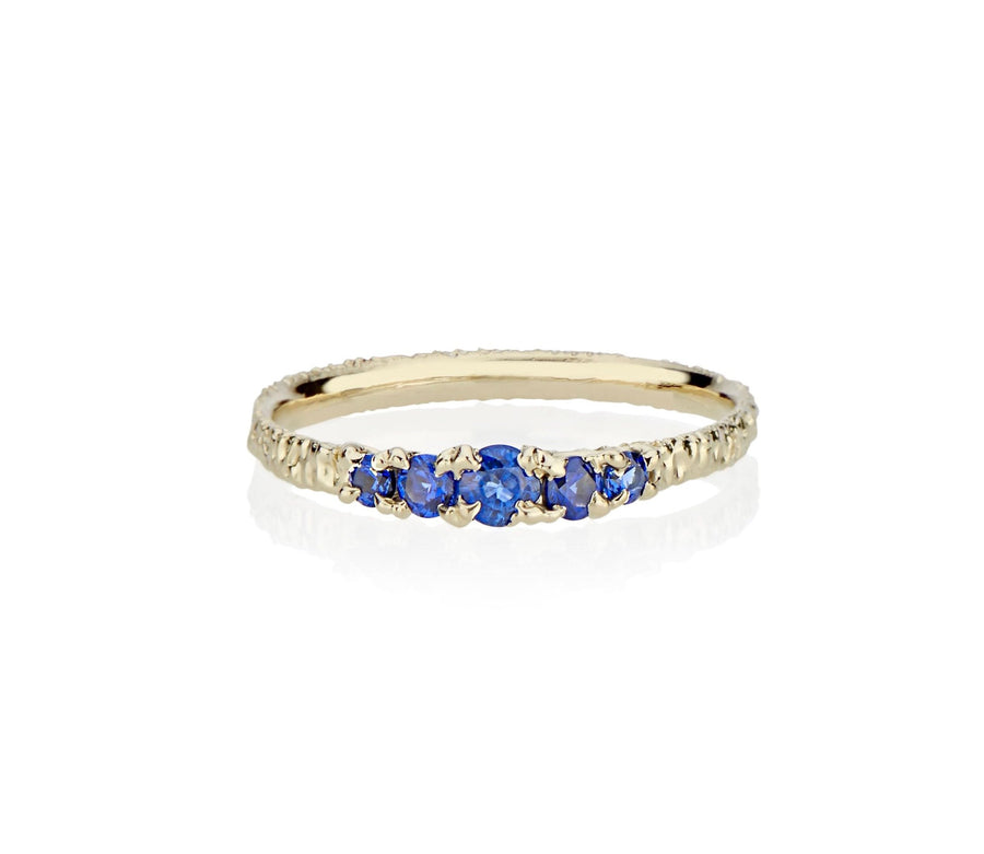 A modern take on victorian style jewelry in this five sapphire ring stack made in nyc by model jayne moore jewelry designer jayne moore from recycled metal royal blue sapphires cast not set cast in place rebel set