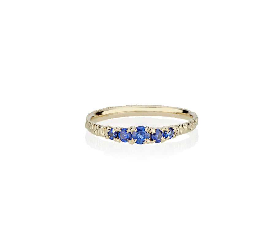 A modern take on victorian style jewelry in this five sapphire ring stack made in nyc by model jayne moore jewelry designer jayne moore from recycled metal