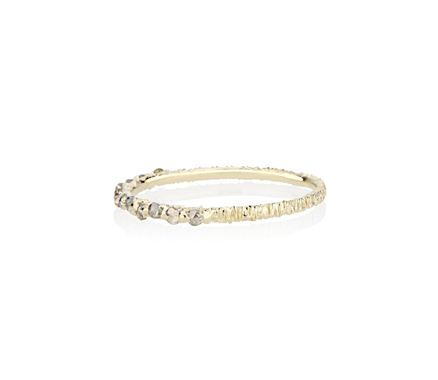 grey champagne and cognac rose cut diamonds are hand set and cast in place on this dainty sparkler of a stackable ring made by model jayne moore jeweler writer jayne moore in her new york studio using recycled gold and certified conflict free diamonds rebel set unconventional ring setting dainty engagement ring cast not set #castnotset