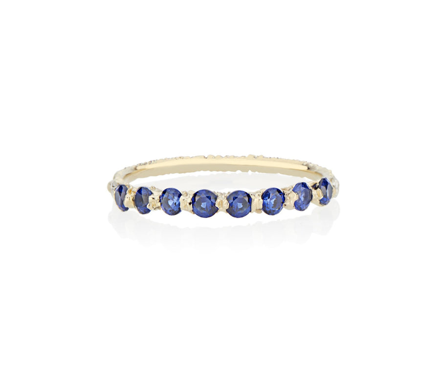 Royal Blue Sapphires cast not set in to 18kt Gold in model turned jeweler Jayne Moore's signature rebel set style using recycled refined golds and sustainable responsibly sourced stones, handmade in NYC stones inspired by the Sicilian sea