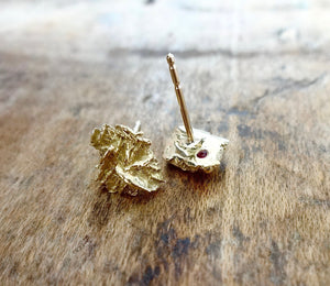 Unique solid gold earrings, earthy natural raw organic textured earrings, 18kt gold studs, cool gold studs, contemporary earrings, sustainable fashion, made in NYC, made in the USA, hidden ruby earrings