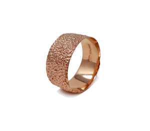 Simple elegant broad ring bands hand textured to emulate the dappled light naturally found in nature handmade in NYC by designer Jayne Moore model Jayne Moore from recycled refined metals in 18kt gold a light classic timeless wedding band for him or for her 18kt rose gold