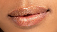 Apply this bronzy golden lip highlighter any way you'd like, but cupids bow and center of lips are a must.