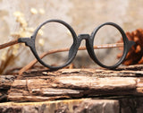 Wood glasses with circular black frame and brown arms