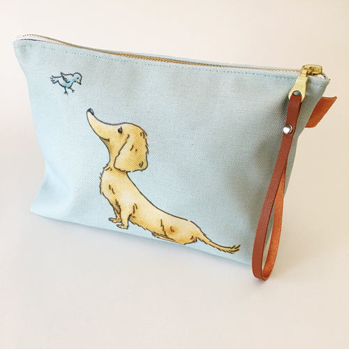 Goldie Dox cosmetic bag - long haired golden dachshund on a seafoam background