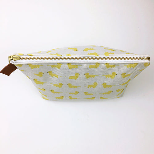 Yellow Cutie Dox Travel Case Cosmetic Bag - yellow dachshunds on a natural background.
