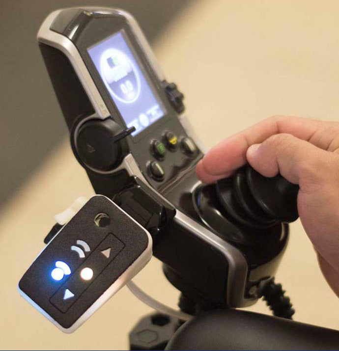 Visual alerts displayed on a controller panel which is mounted to the wheelchair joystick