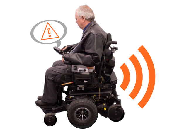 Back up sensor system for wheelchairs, man in power wheelchair with sensors alerting him to an object in his environment