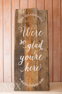 "Wooden Sign ""We're so glad you're here"" free standing"