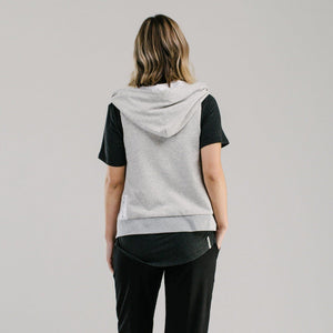 Light grey vest with white lined hood and mint drawstring cord back view