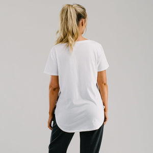 White long t-shirt with scoop hem back worn by size 12 model