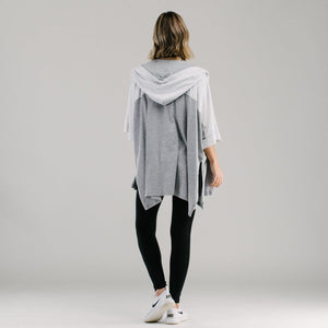 Hood kimono with top panel white and light grey bottom panel back view with full length black leggings