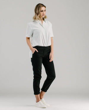 Classic style black chino pants style by rolling up the cuffs