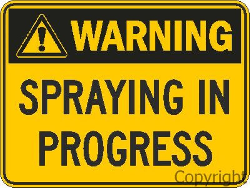 Warning Spraying In Progress Sign