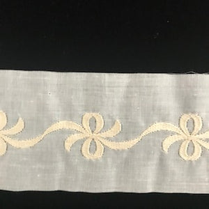 E-93 Ivory, Ecru and Ecru on White - 60mm Embroidered Insertion with Bows.