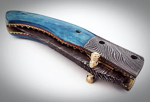 UK-1075, Custom Handmade Damascus Steel Folding Knife - Colored Bone Handle with Damascus Steel Bolsters Amazing File Work.