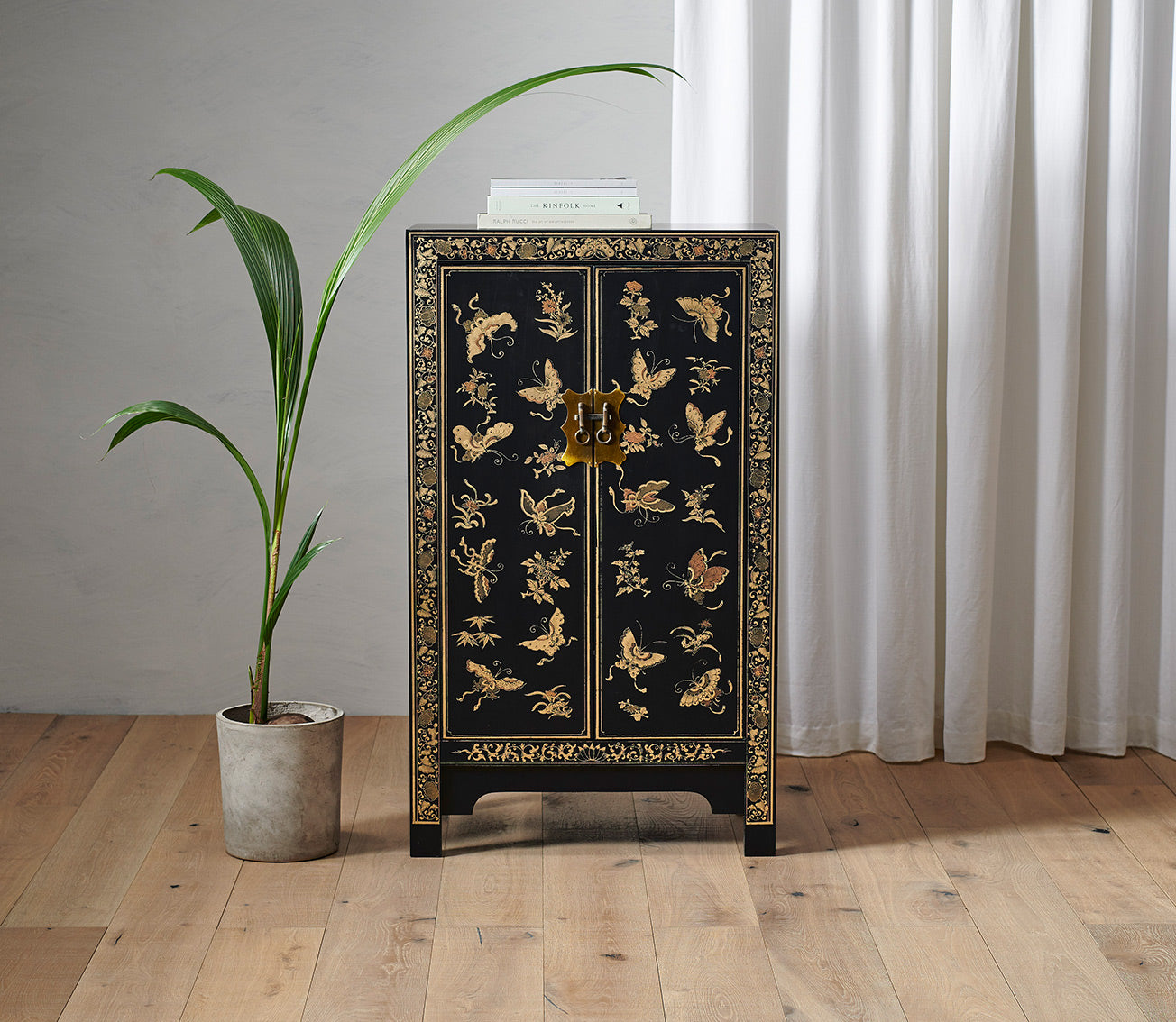 Oriental decorated black medium cabinet
