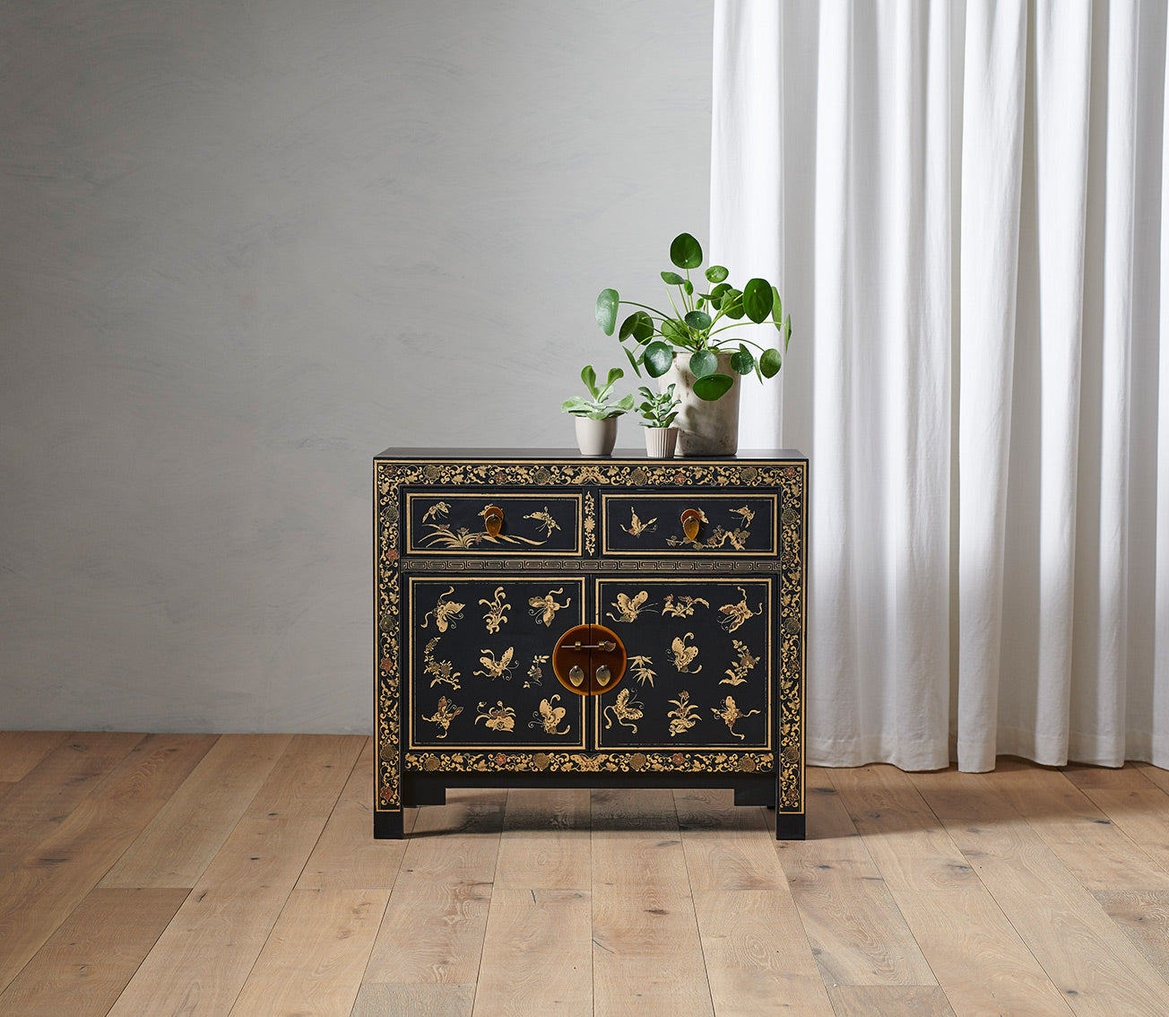 Oriental decorated black sideboard