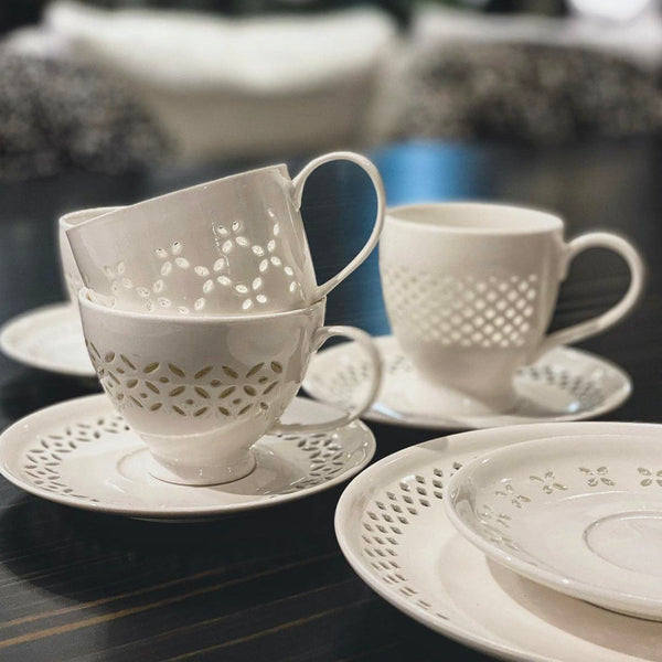 PIERCED CUPS AND SAUCERS <br> SET OF 4