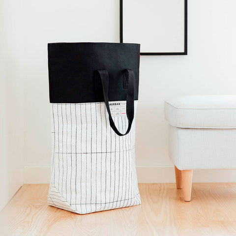 reisenthel #urban laundry tokyo black & white laundry basket in room