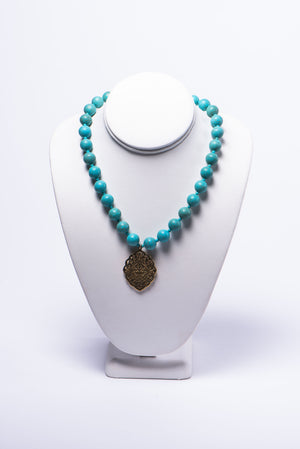NADIA DAJANI - NECKLACE - TURQUOISE BEADS WITH GOLD-PLATED ARABESQUE PENDANT